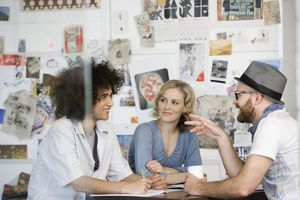 Young graphic designers talking in an art space