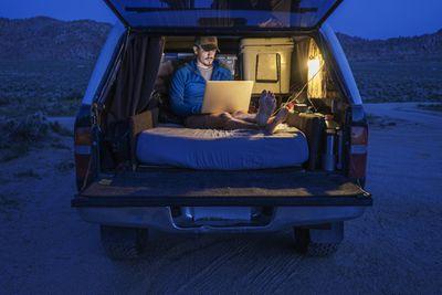Camper using power inverter to run laptop
