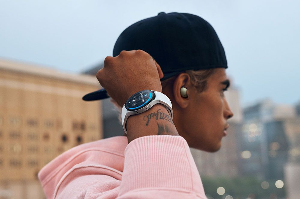 Person wearing the Galaxy Watch 4 and wireless earbuds
