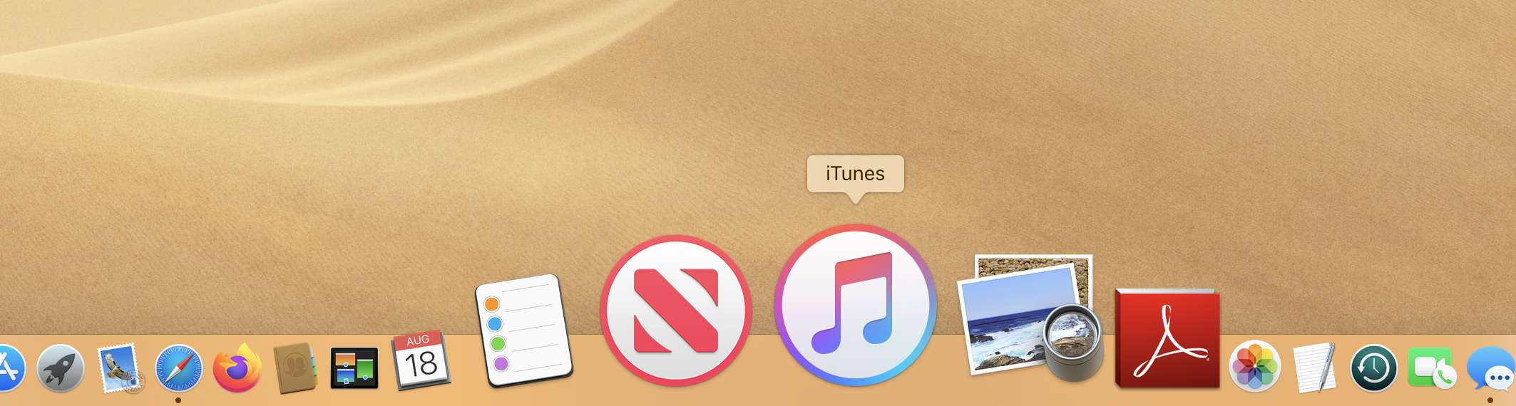 The Mac Dock with iTunes selected
