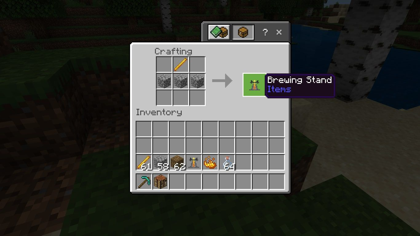 Add a Blaze Rod to the middle of the top row and three Cobblestones in the middle row.