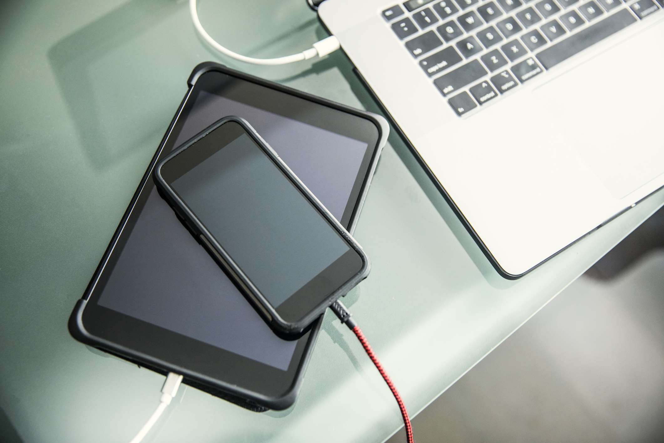 Mobile devices and laptop charging on office desk