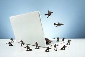 Toy soldiers surrounding computer