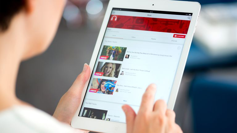 Woman using the official YouTube app on an Apple iPad