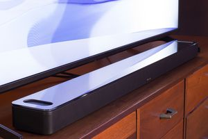 The Bose Soundbar 900 sitting in front of a television.