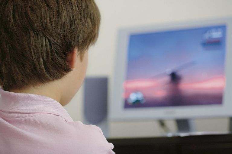 Child playing a PC game