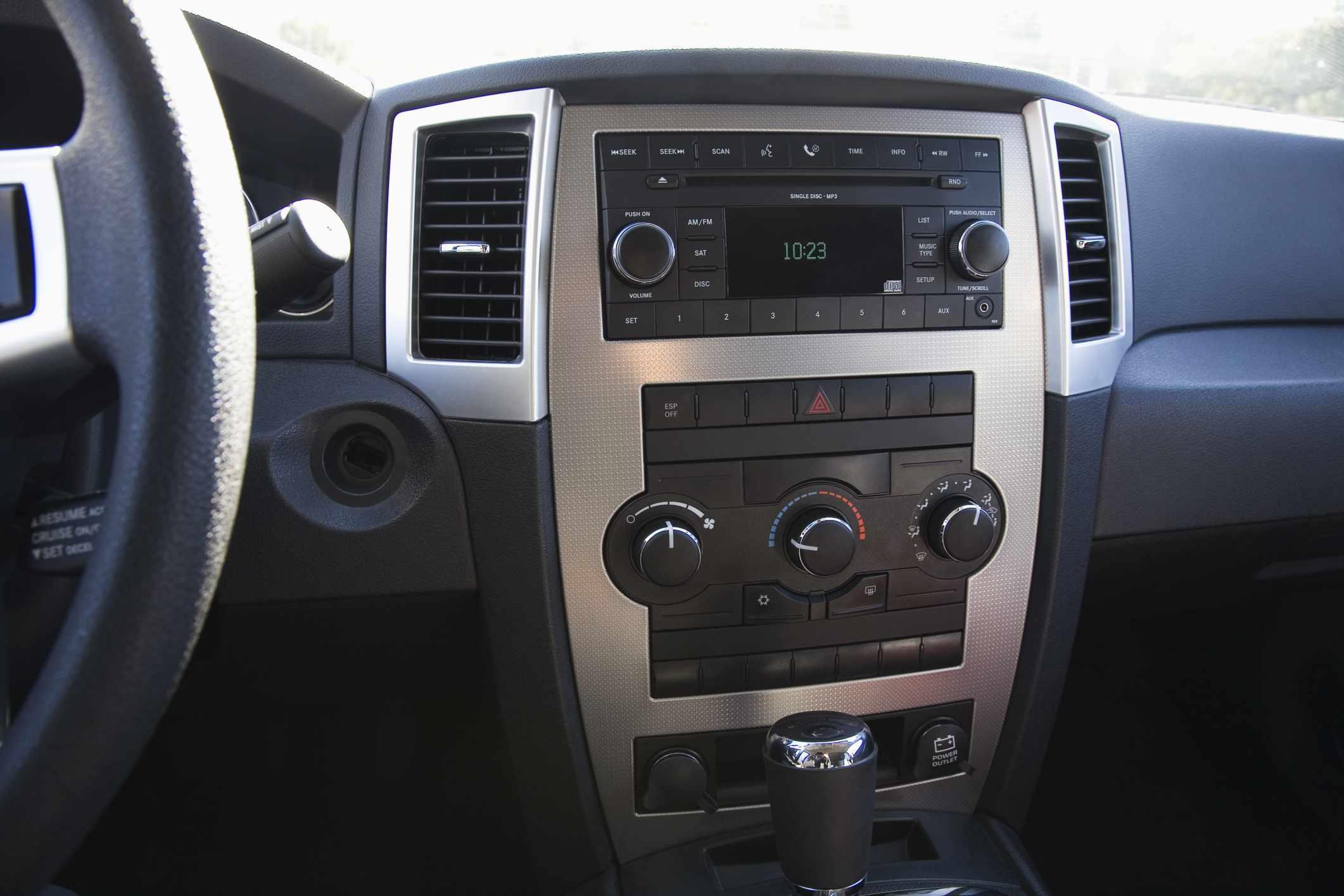 Cigarette lighter sockets in a car dashboard.