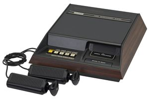 The Fairchild Channel F with hard-wired controllers. A second-generation video game console released in 1976.