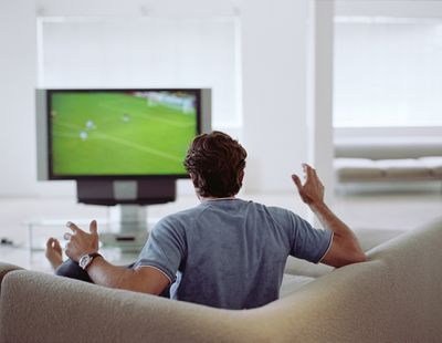 Man watching sports on TV