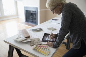 Senior using Apple Pencil on tablet