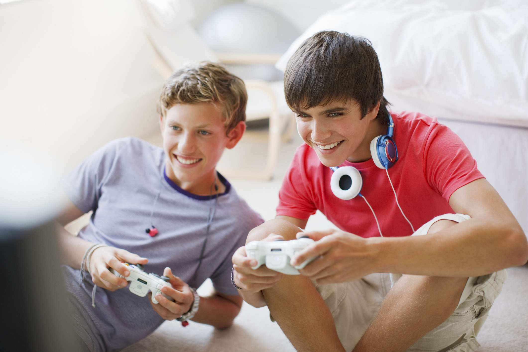 Two teenagers playing video games.