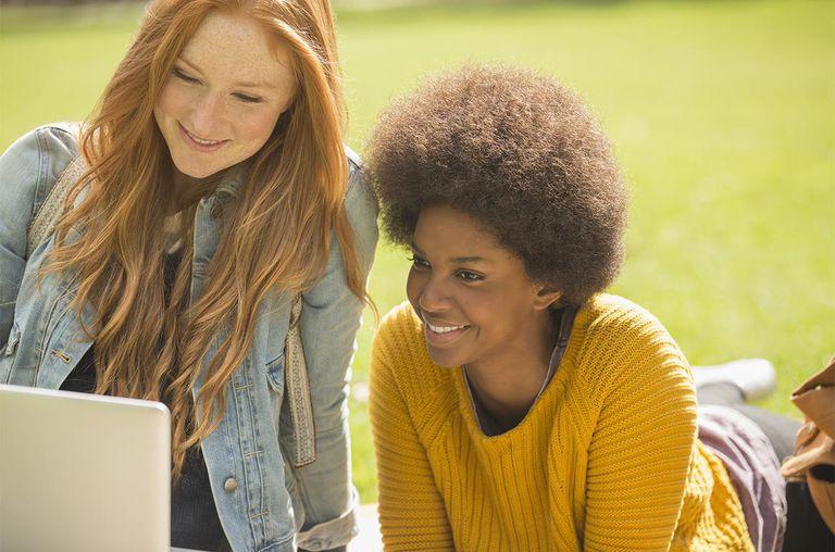 Women using laptop in park