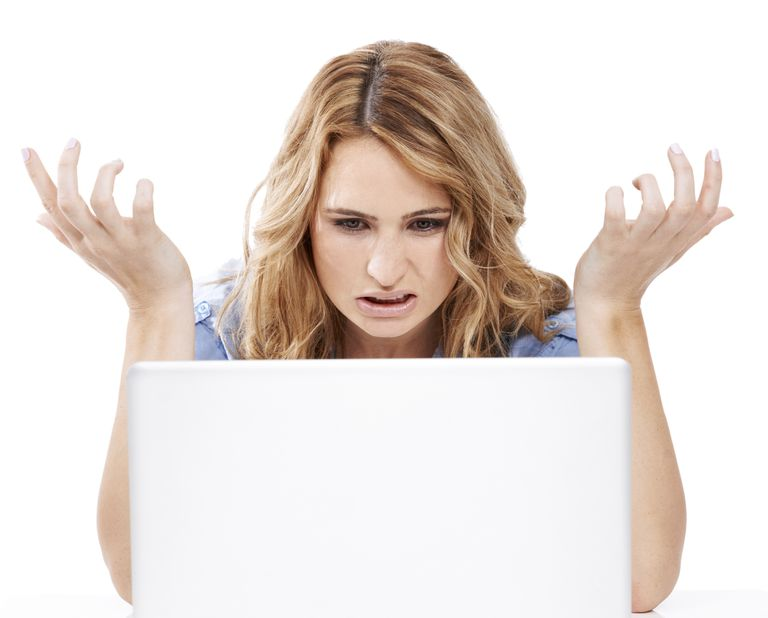 Woman looking at her laptop in frustration.