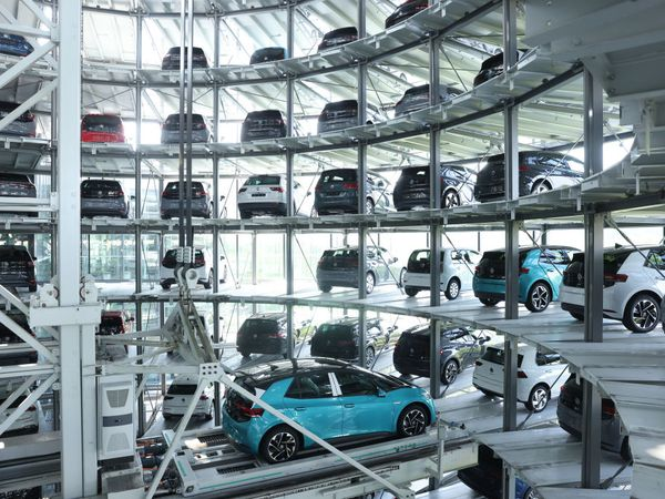 A VW production facility showing electric cars being stowed for eventual sale.
