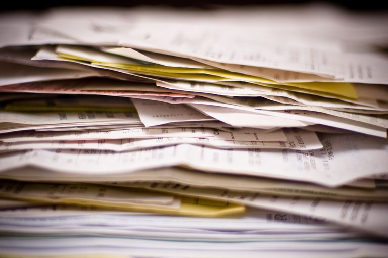 A stack of receipts and other paperwork