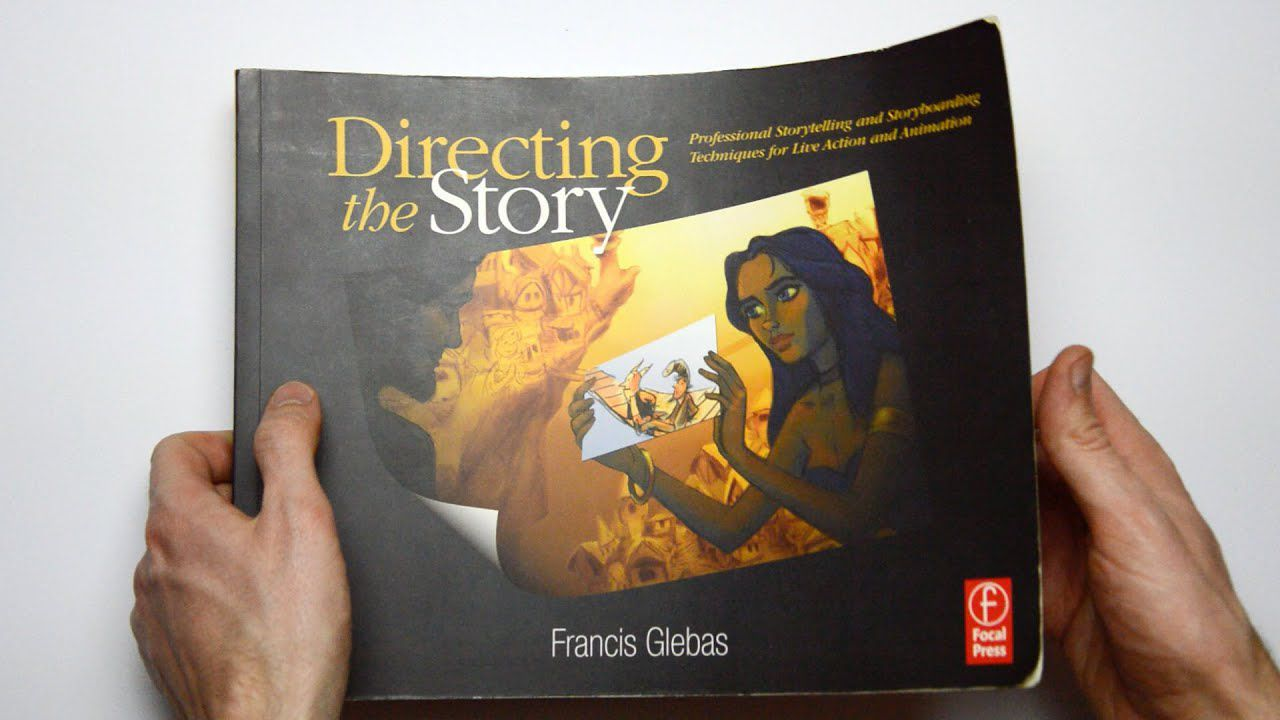 A person holding a copy of Directing the Story