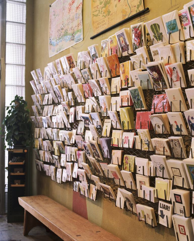 Greeting cards displayed on wall in shop