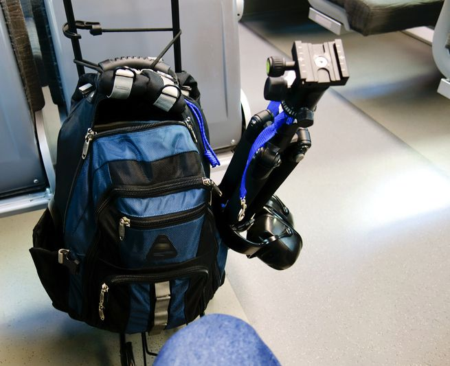 Rolling rucksack luggage with travel tripod