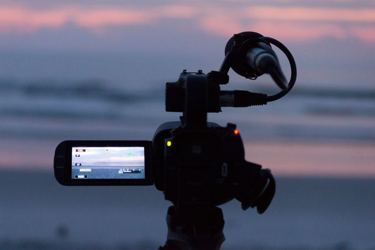 Close-Up Of Home Video Camera At Beach During Sunset