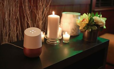 A Google Home device sits on a table awaiting commands