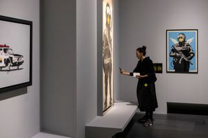 Woman photographing art in a museum