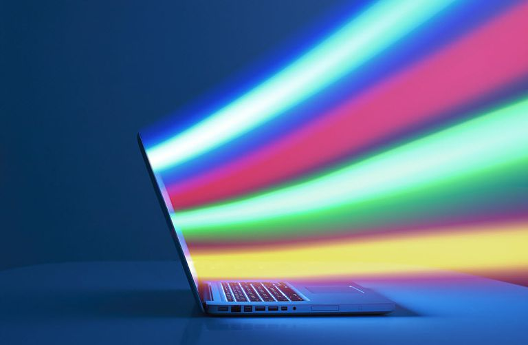 Laptop computer showing multiple colored lines coming from the screen to illustrate TorrentZ downloads.
