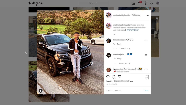 Instagram influencer standing standing in front of vehicle
