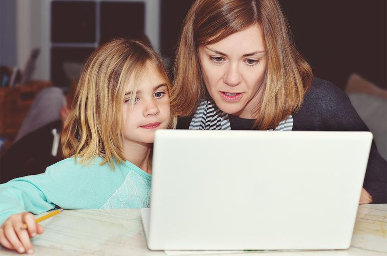 Woman and young girl working at a laptop