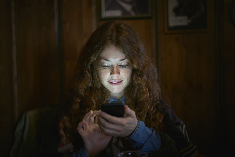 woman texting at night.