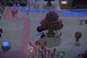 Harvesting wood from a tree in Animal Crossing: New Horizons