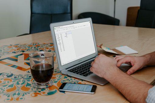 A MacBook running Google Sheets
