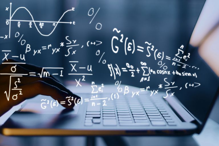Hand on computer with math formulas illustrated coming out of it