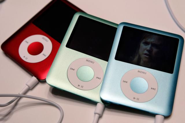 Three iPod Nanos on a table