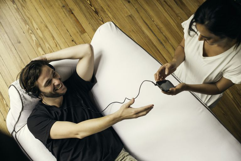 Photo of a woman and a man listening to streaming music