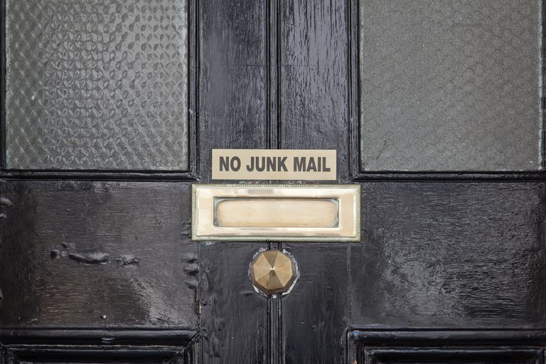 Door mail slot with NO JUNK MAIL sign above it