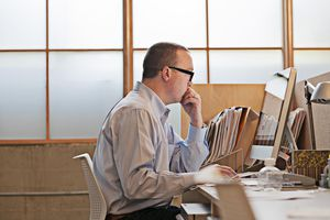 Man reads email at desk