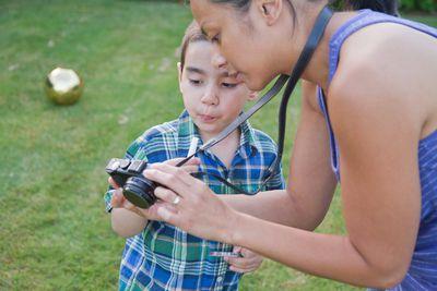 Mother and son using Nikon Camera