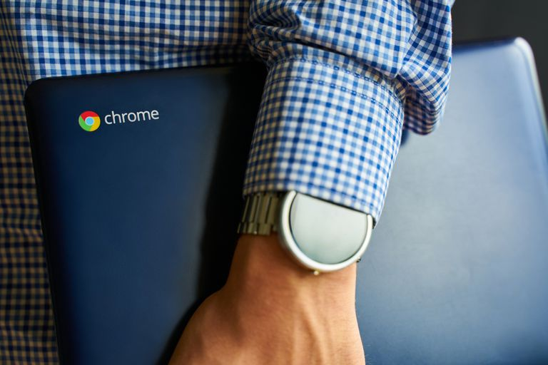 picture of someone holding a Chromebook