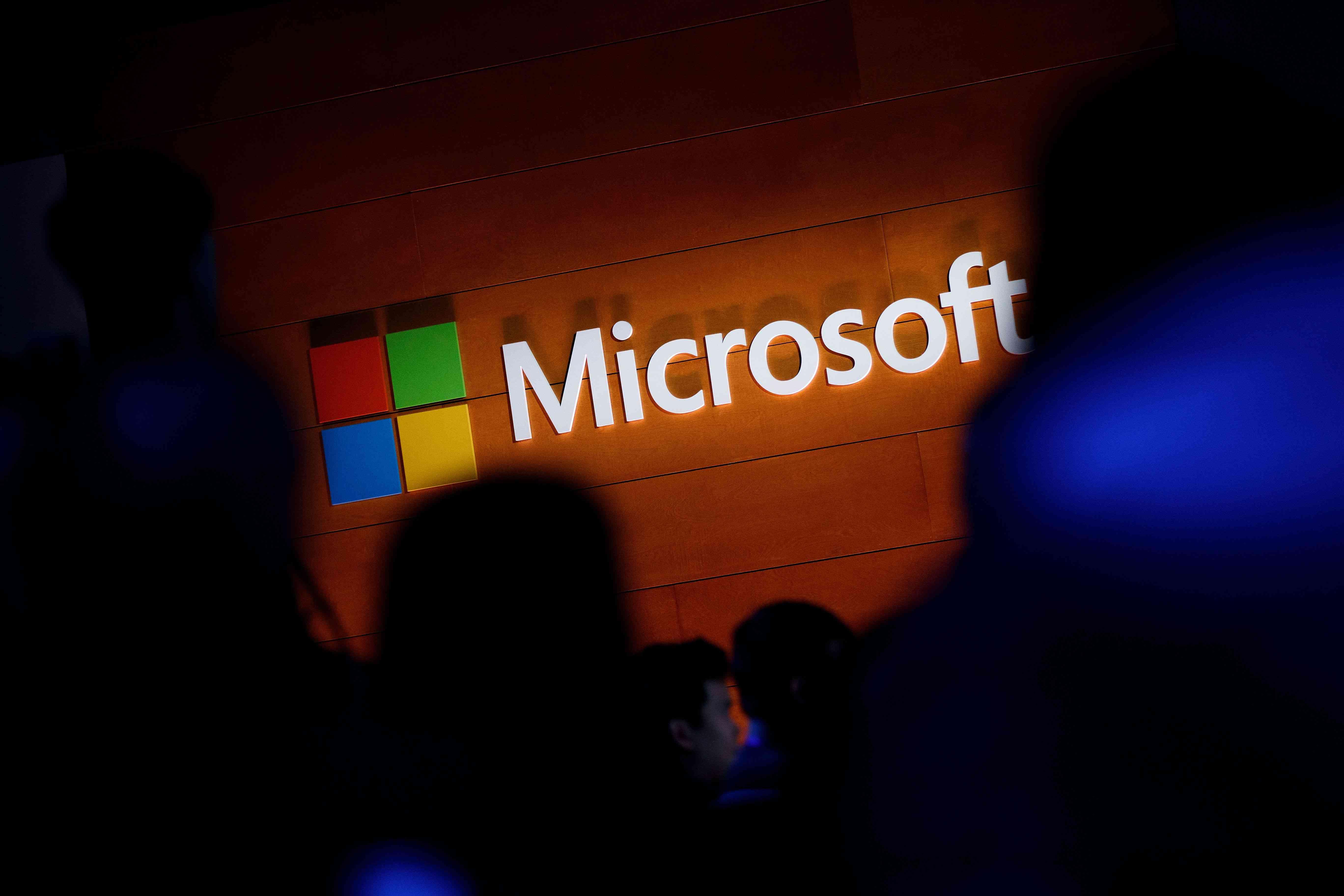 Microsoft logo on a brown wall