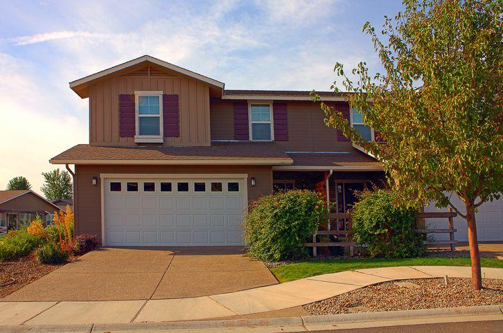 House and driveway in suburban neighborhood