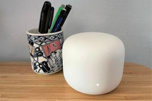 A photo of a Google Nest Wi-Fi router on a desk