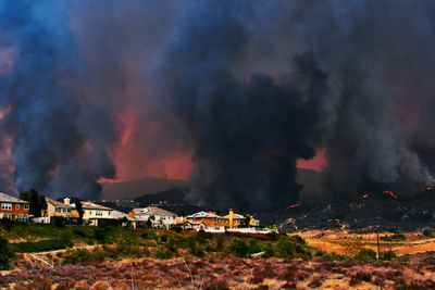 Image of a wildfire approaching houses