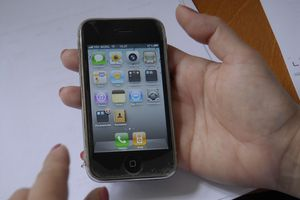 consumer holding apple iphone