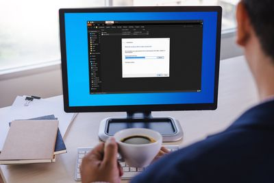 A man adds programs to the Windows 10 startup folder.