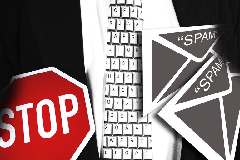 Stop sign with keyboard and spam email, depicting anti-spam add-ins for Outlook