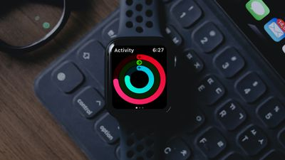 Activity rings on Apple Watch placed on keyboard