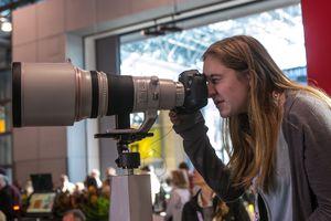 Photographer using a telephoto lens