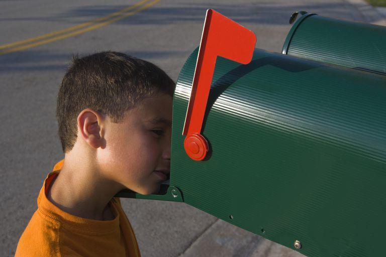boy looking in mailbox