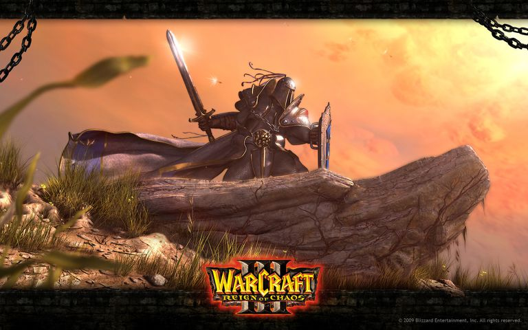 Armored fantasy warrior on a rock from Warcraft III: Reign of Chaos