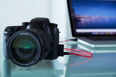 DSLR Camera tethered to a laptopt computer via USB cable.